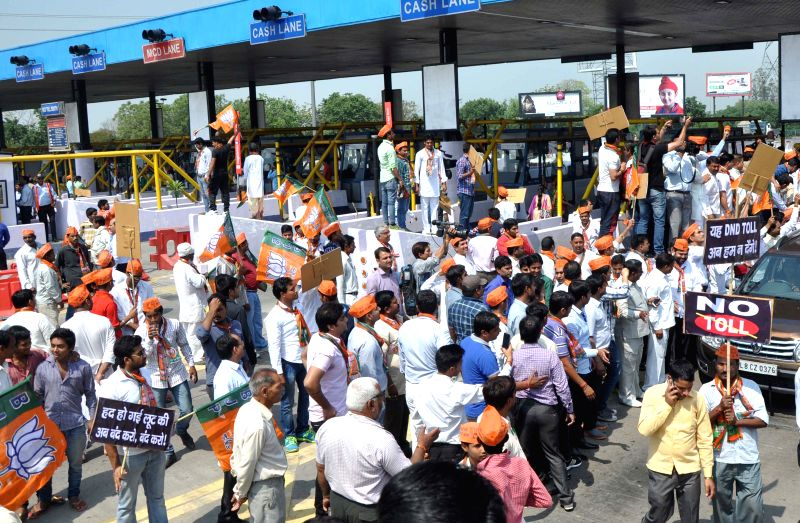 BJP workers stage a demonstration on the Delhi-Noida Direct (DND) flyway against toll in New Delhi, on April 8, 2015.