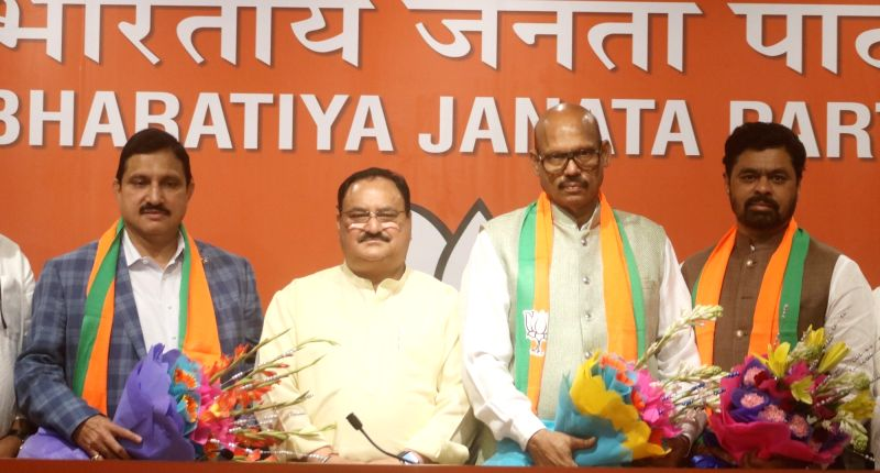 New Delhi: BJP Working President J.P. Nadda with TDP MPs T. G. Venkatesh and Y. S. Chowdary who joined the BJP, at the party's headquarters in New Delhi on June 20, 2019. (Photo: IANS)