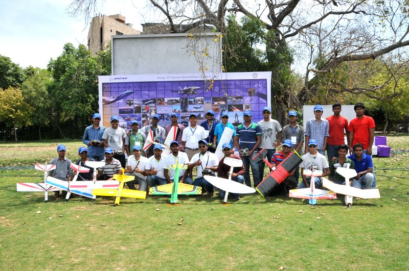 Boeing India president Pratyush Kumar with the finalists of `Aero-modelling Competition` at IIT Delhi in New Delhi on April 11, 2015. - Pratyush Kumar