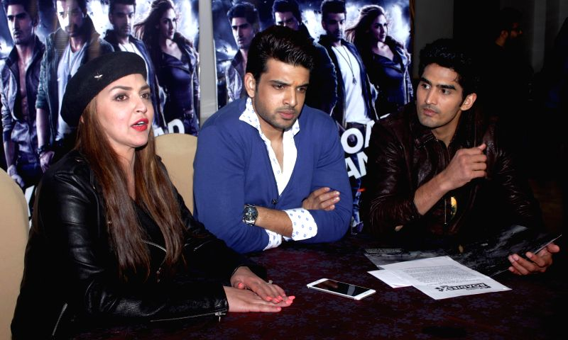 Boxer Vijender Singh with actors Esha Deol and Karan Kundra address during a press conference regarding MTV Rodies X2 in New Delhi on Dec. 13, 2014.