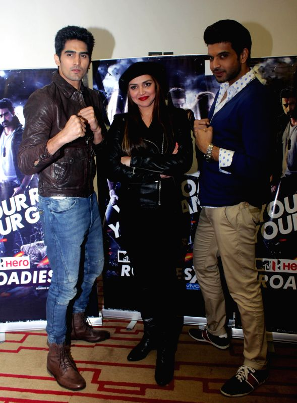Boxer Vijender Singh with actors Esha Deol and Karan Kundra during a press conference regarding MTV Rodies X2 in New Delhi on Dec. 13, 2014.