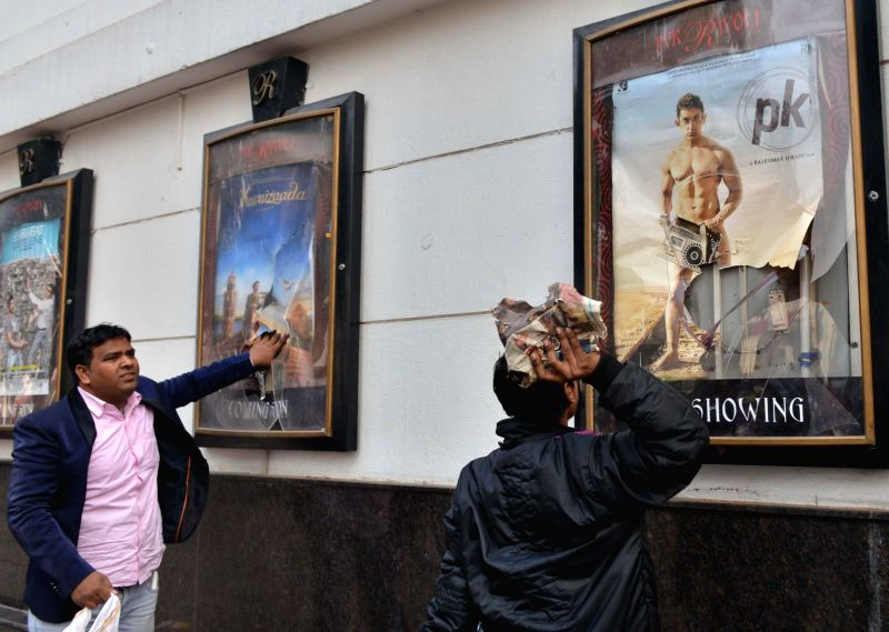 Broken posters frame  at a Delhi theatre screening Amir Khan starrer `PK`  in New Delhi, on Dec 28, 2014. Hindu Sena activists  staged a protest against the film at Connaught Place. - Khan
