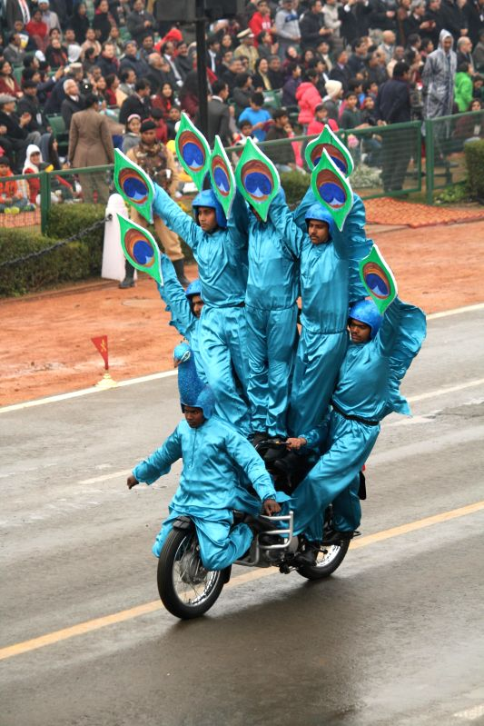 BSF soldiers showcase their `Peacock formation` aboard a motorcycle during the Republic Day parade in  New Delhi, on Jan 26, 2015.