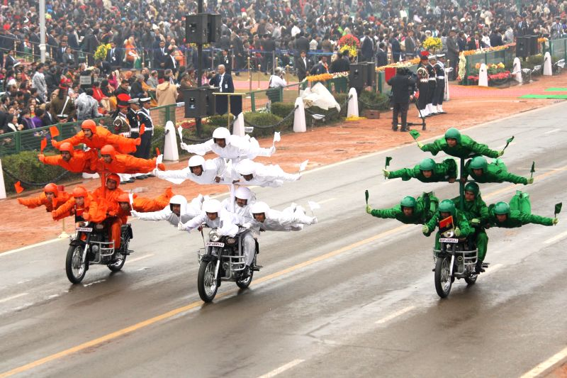 BSF soldiers showcase their skills aboard a motorcycle during the Republic Day parade in  New Delhi, on Jan 26, 2015.