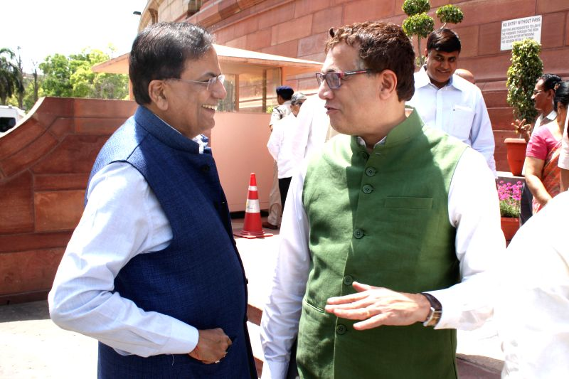 BSP MP Satish Chandra Misra and Trinamool Congress MP Derek O`Brien at the Parliament house in New Delhi, on April 23, 2015.