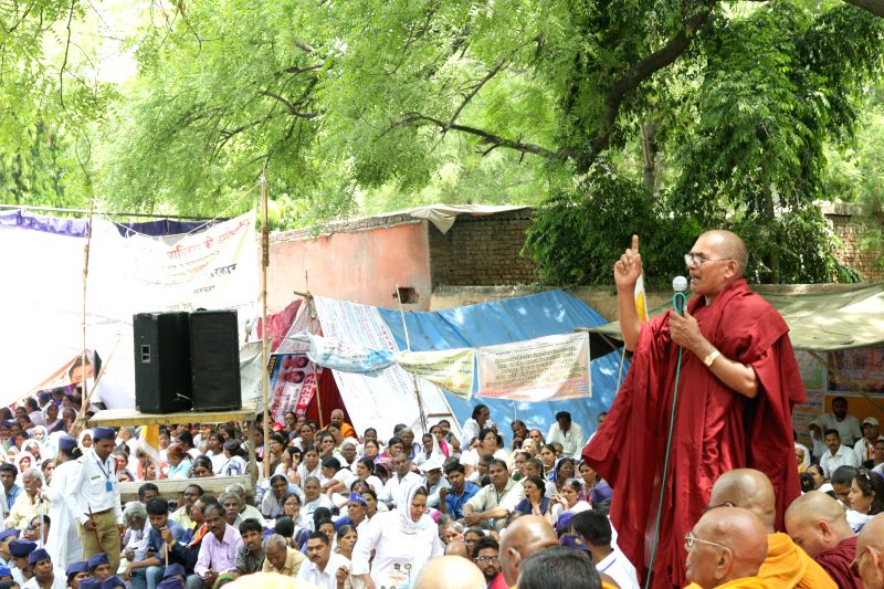 Buddhists stage a demonstration at Jantar Mantar in New Delhi on April 27, 2015.