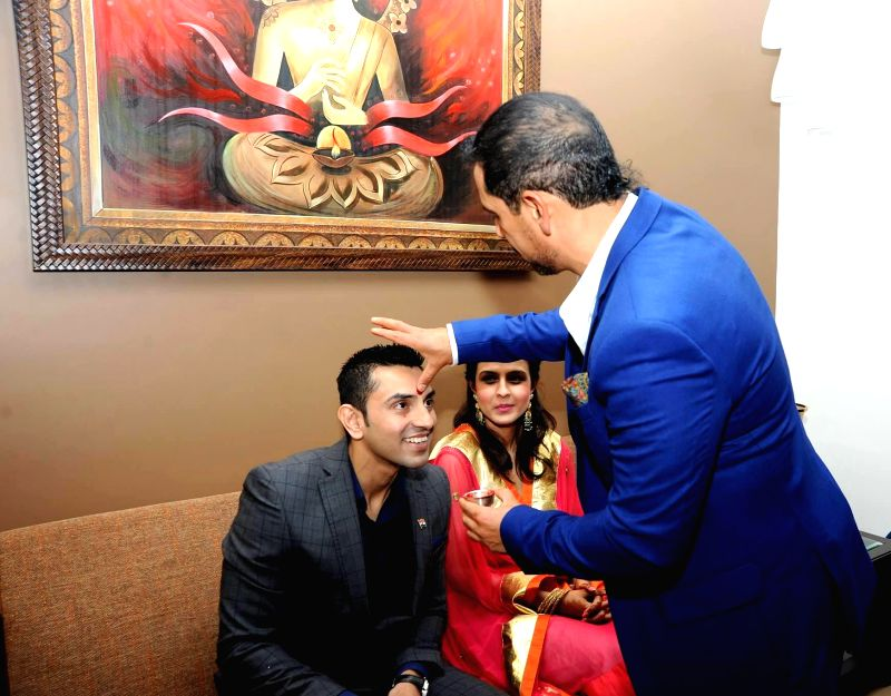 Businessman Robert Vadra with his cousin sister Monika Vadra and her fiance Tehseen Poonawalla during a family function at Vadras' New Delhi residence on March 8, 2015.