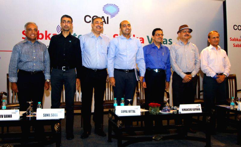 Cellular Operators Association of India (COAI) chief Rajan S Mathews, Telenor Group Chief Representative Officer Rajiv Bawa, Vodafone India's CEO-designate Sunil Sood, Bharti Airtel CEO ... - Ashok Sharma