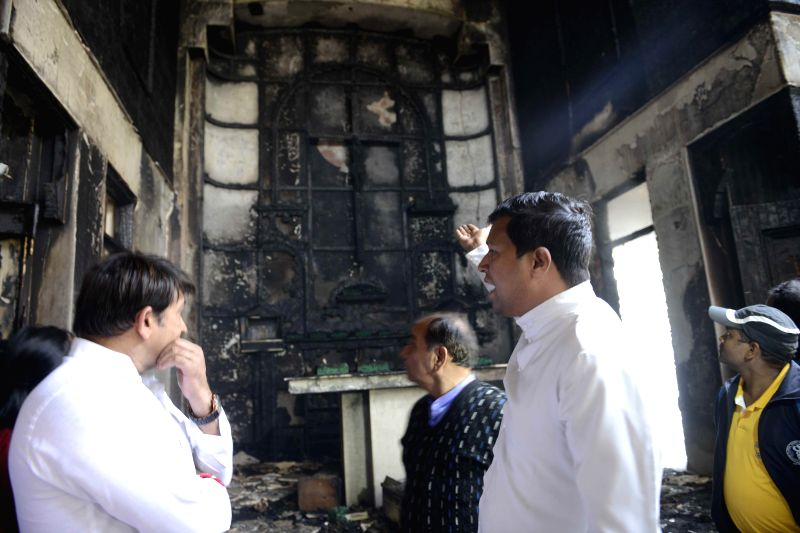Chancellor of Archdiocese of Delhi Father Mathew Koyickal visits charred  St Sebastian's Church at Dilshad Garden in Delhi, on Dec 1, 2014.