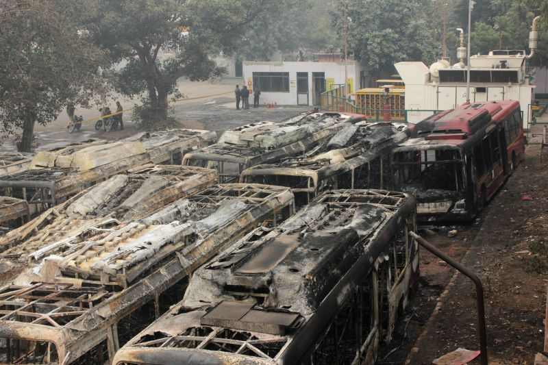 Charred remains of the buses destroyed in a fire that broke out at Ambedkar Nagar bus depot in New Delhi on Jan 1, 2015. Reportedly 17 low floor air-conditioned buses were gutted in the ...