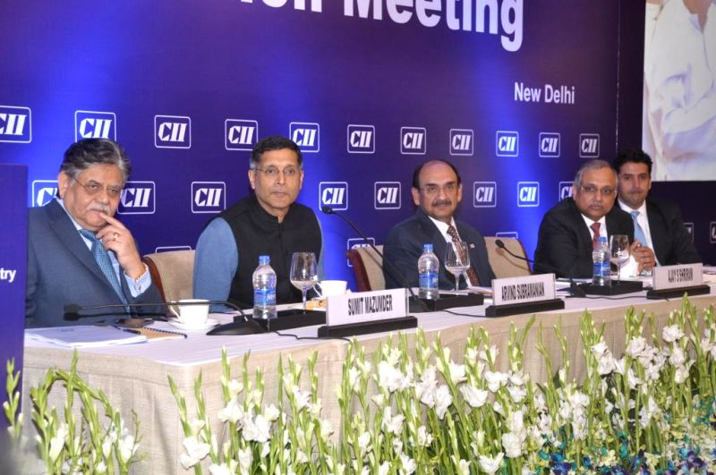 Chief Economic Advisor of the Union Finance Ministry Dr. Arvind Subramanian and others during the National Council meeting of the CII in New Delhi, on March 1, 2015.