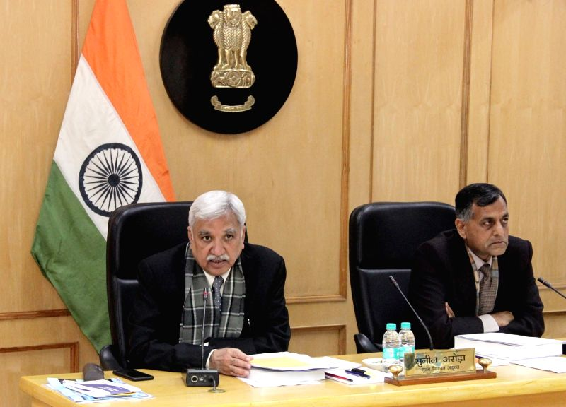 New Delhi: Chief Election Commissioner Sunil Arora and Election Commissioner Ashok Lavasa at a review meeting for Poll Preparedness with all State CEOs, in New Delhi on Jan 12, 2019. (Photo: IANS/PIB)