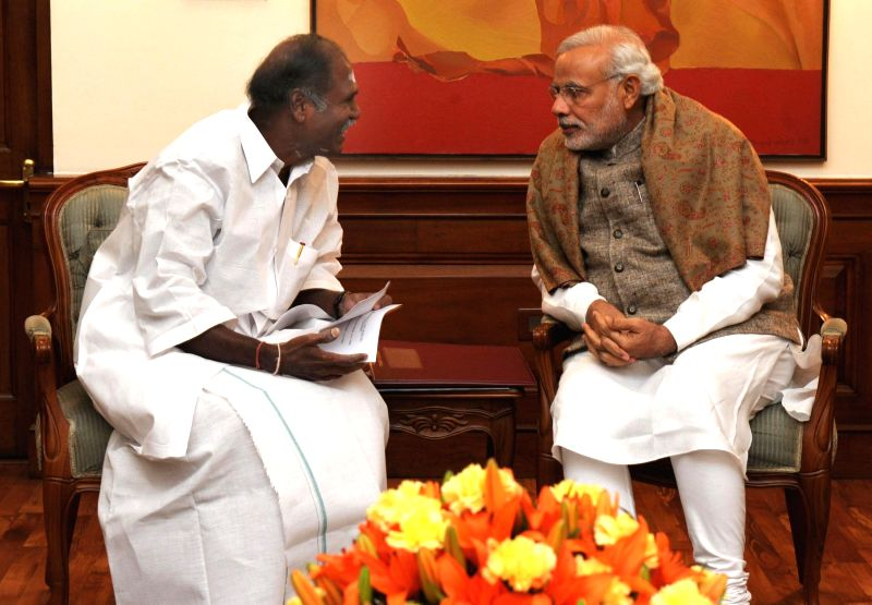 Chief Minister of Puducherry N. Rangasamy calls on Prime Minister Narendra Modi, in New Delhi on Dec 12, 2014. - Narendra Modi