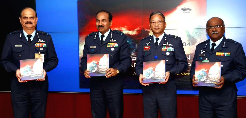 Chief of the Air Staff, Air Chief Marshal Arup Raha release a book titled `A Few Good Men and the Angry Sea` written by Air Commodore Nitin Sathe, in New Delhi, on Dec 26, 2014.