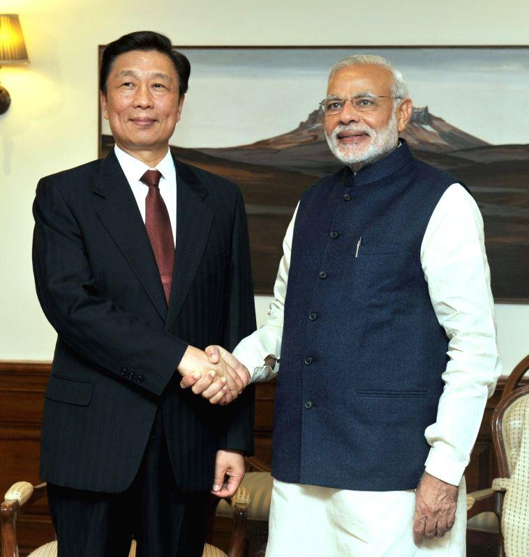 :New Delhi: China Vice President Li Yuanchao meets the Prime Minister Narendra Modi, in New Delhi on Nov. 6, 2015. (Photo: IANS/PIB). - Narendra Modi