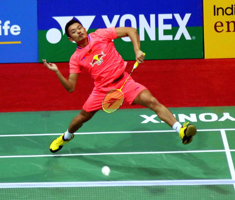 Chinese badminton player Lin Dan returns a shot to Ho Yue of Hong Kong during a match of Yonex Sunrise Indian Open Badminton Championship in New Delhi on March 26, 2015. Lin Dan won. Score ...