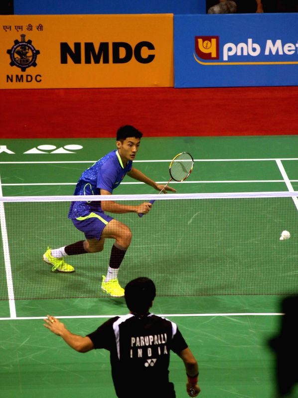 Chinese badminton player Xue Song returns a shot to Parupalli Kashyap of India during a match of Yonex Sunrise Indian Open Badminton Championship in New Delhi on March 26, 2015. Parupalli ...