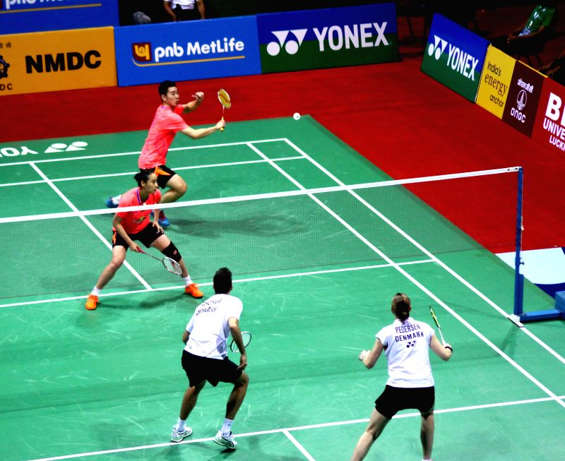 Chinese badminton players Bao Yixin and Liu Cheng in action against their Danish counterpart Joachim Fischer Nielsen and Christinna Pedersen during a mixed doubles match of Yonex Sunrise ...