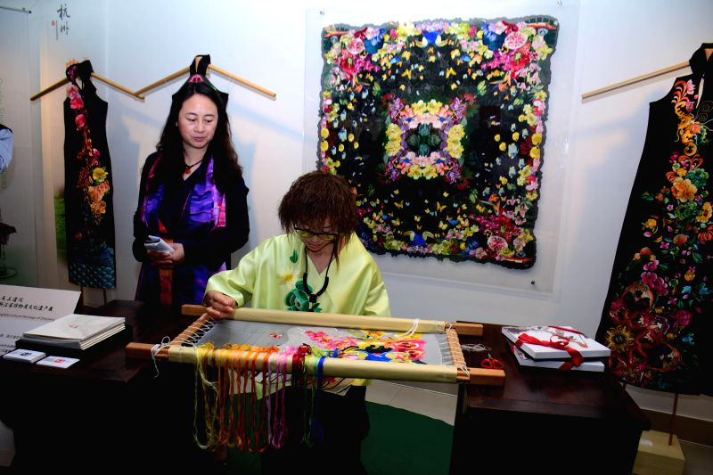 Chinese craftswomen during `Zhejiang Cultural Exhibition` organised by FICCI in partnership with the Chinese Embassy in India  at Arts and Crafts Society in New Delhi, on Nov 21, 2014.