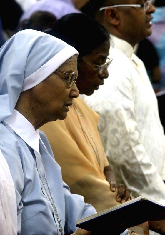 Christian nuns offer prayers at a Delhi Church on Good Friday on April 3, 2015.