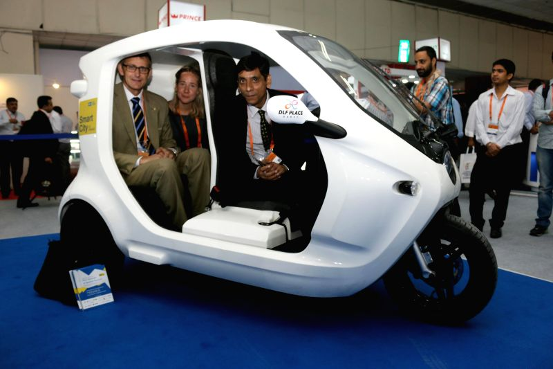 Clean Motion CEO Goran Folkesson and India Head Anil Arora at the launch of Zbee - an electronic vehicle at Smart City Expo in New Delhi, on May 20, 2015. - Anil Arora