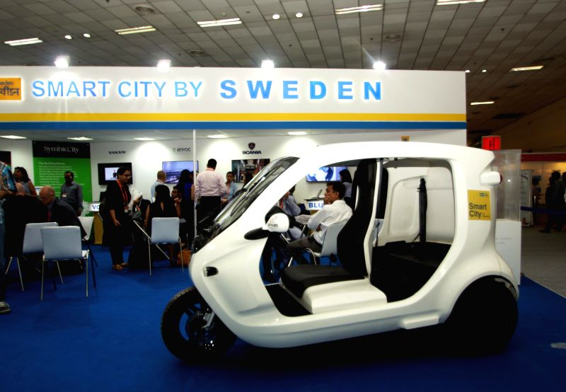 Clean Motion launches Zbee - an electronic vehicle at Smart City Expo in New Delhi, on May 20, 2015.