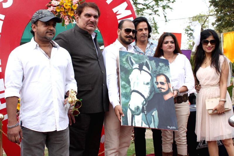 Composer Sajid Ali Khan with actors Raza Murad and Rahul Roy during the `The Rolli Stud Farm Million Cup` at Delhi Race course, in New Delhi on April 6, 2015.