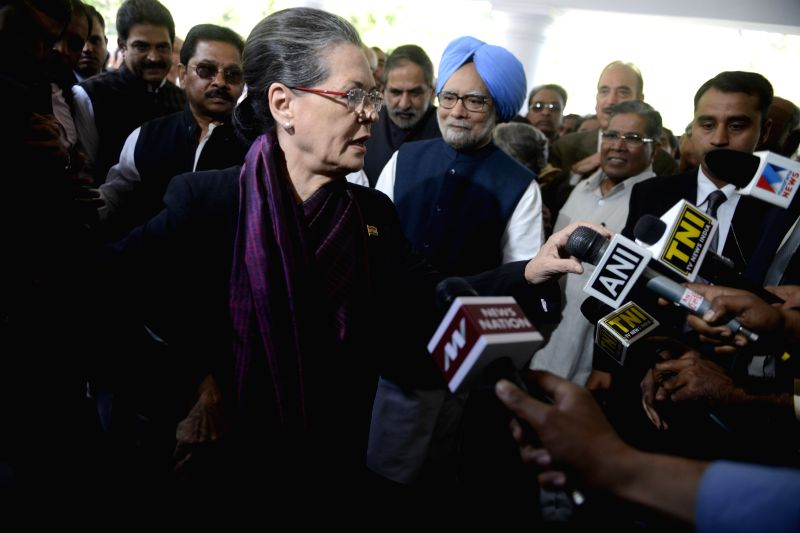 Congress chief Sonia Gandhi talks to press in New Delhi, on March 12, 2015. Also seen former prime minister Manmohan Singh. - Manmohan Singh