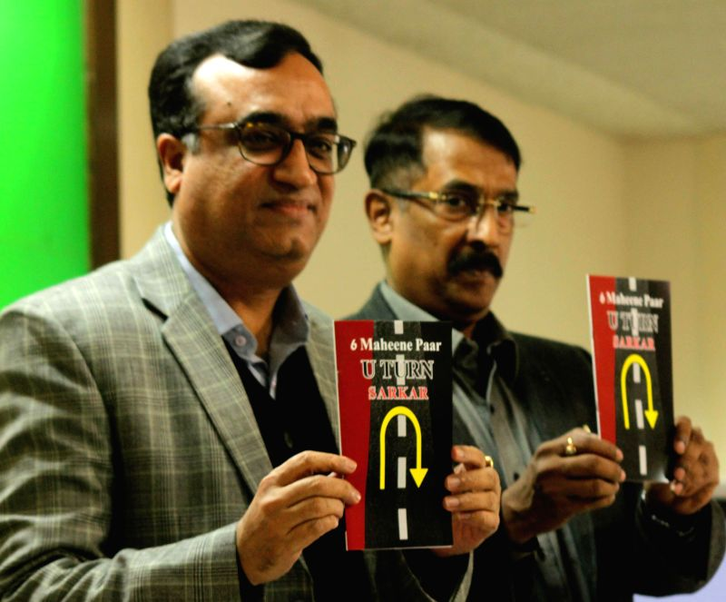 Congress leader Ajay Maken at the launch of `6 Mahine Paar U-Turn Sarkar' - a book during a press conference in New Delhi, on Dec 1, 2014.