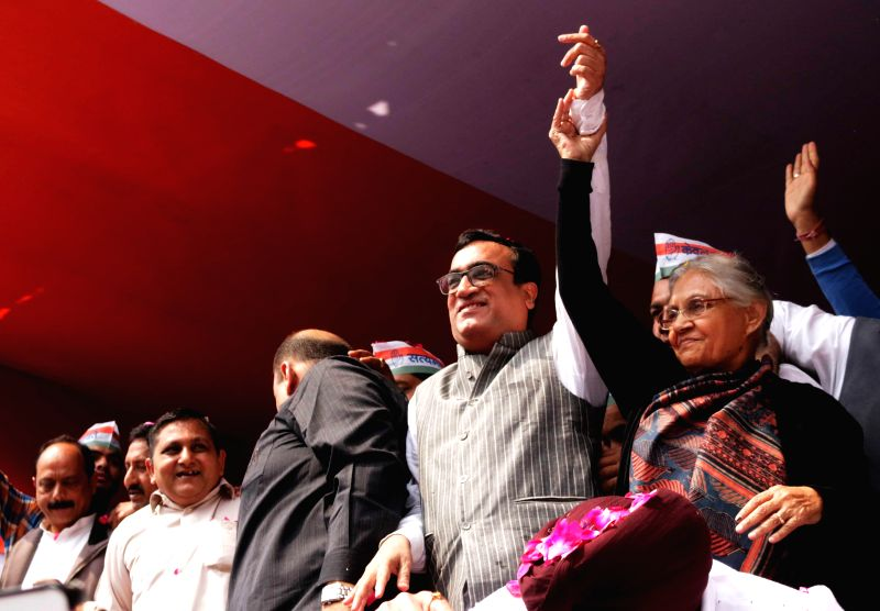 Congress leader Ajay Maken with party leader Shiela Dikshit during a programme where he was made party's Delhi unit chief  in New Delhi, on March 8, 2015. - Shiela Dikshit