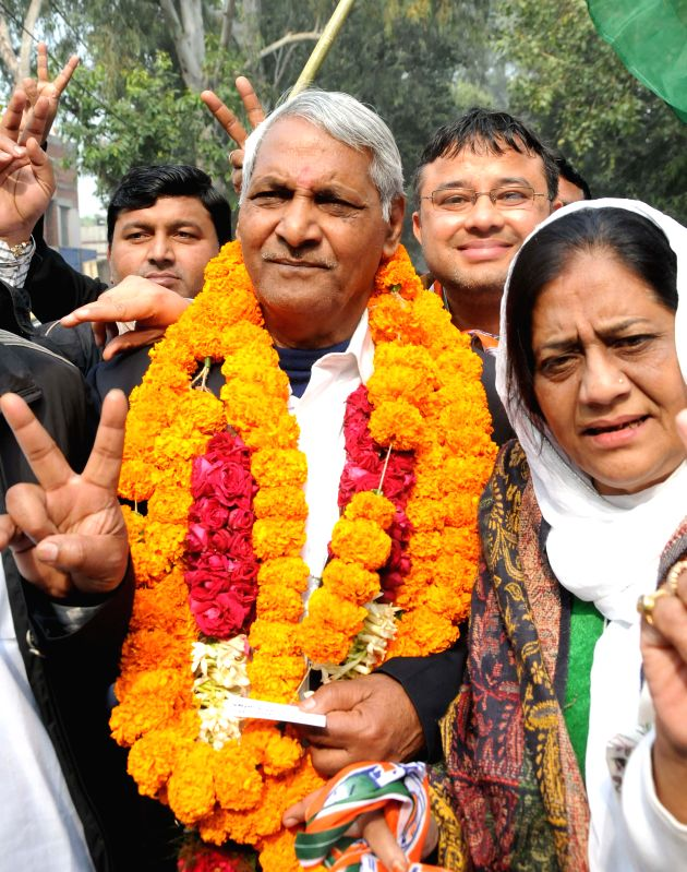 Congress leader Brahm Pal arrives to file his nomination papers for upcoming Delhi assembly polls at Geeta Colony SDM office in New Delhi, on Jan 19, 2015.