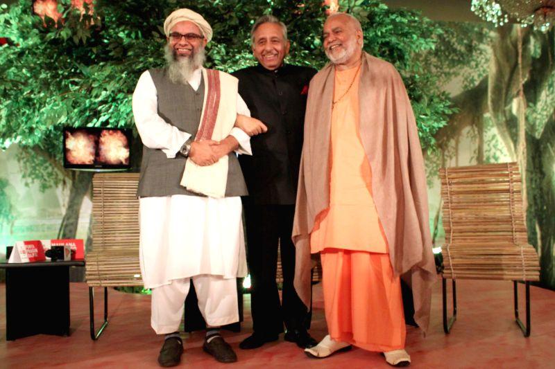 Congress leader Mani Shankar Aiyar, Jamat-Ulama-e-Hind leader Maulana Mahmood Madani and  spiritual leader Swami Chinmay Saraswati during a programme organised by Aaj Tak news channel in .