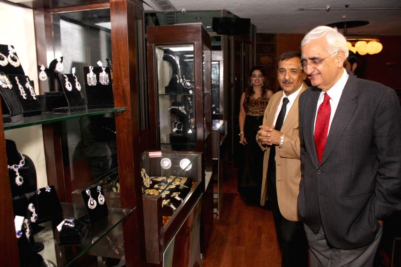 Congress leader Salman Khurshid during the launch of jewellery designer Chitwan Malhotra`s collection in New Delhi on Dec 9, 2014.