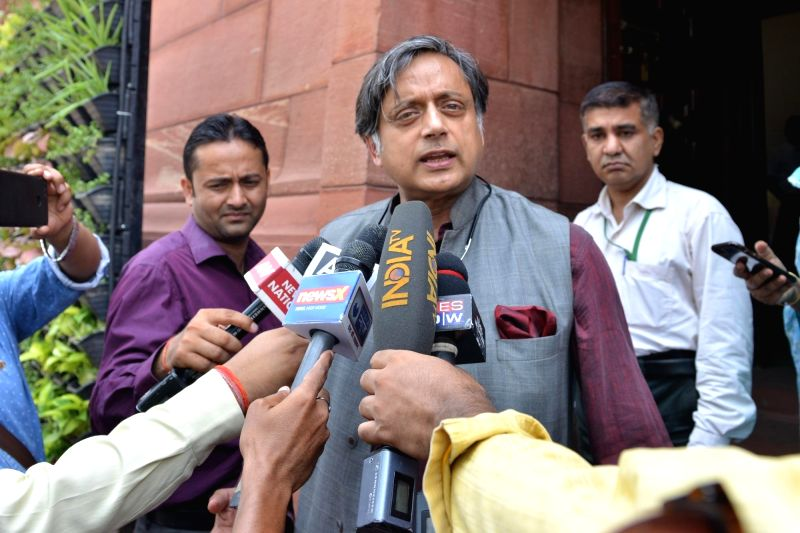 :New Delhi: Congress leader Shashi Tharoor talks to press during day-2 of Parliament's monsoon session, in New Delhi, on July 19, 2018.(Photo: IANS).