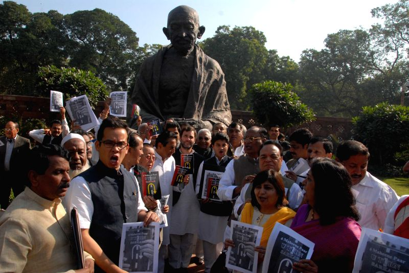 Congress leaders led by party vice president Rahul Gandhi stage a demonstration against the NDA government in the Parliament premises in New Delhi on Dec 2, 2014.