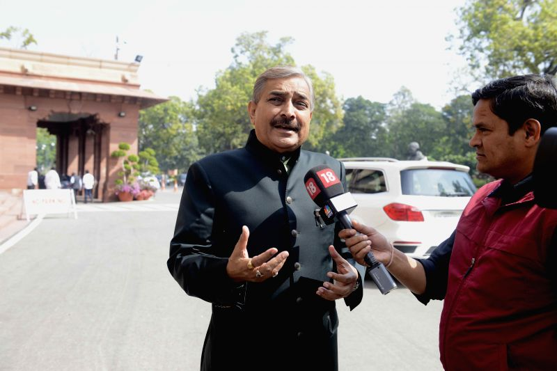 Congress MP Pramod Tiwari talks to press at the Parliament in New Delhi, on March 11, 2015.