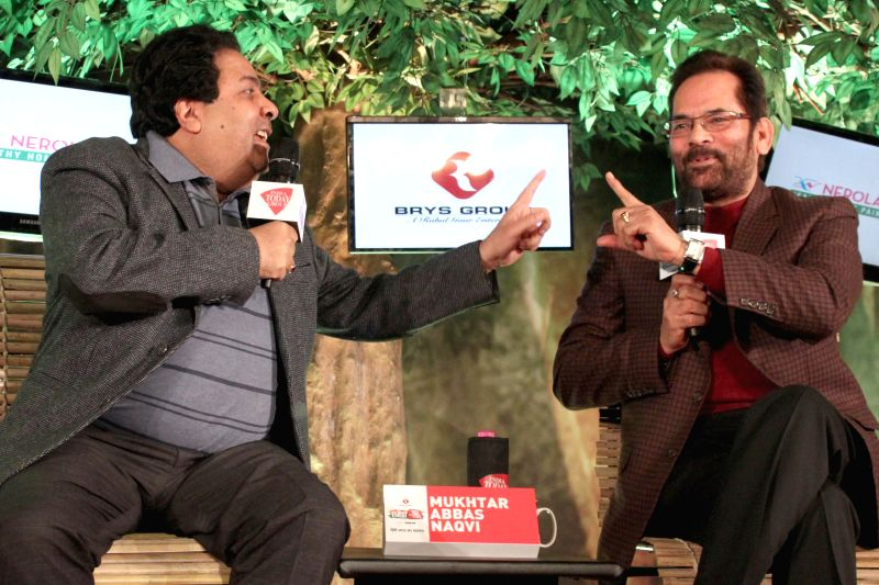 Congress MP Rajiv Shukla with Union MoS for Minority Affairs and Parliamentary Affairs Mukhtar Abbas Naqvi during a programme organised by Aaj Tak news channel in New Delhi, on Dec 13, ...