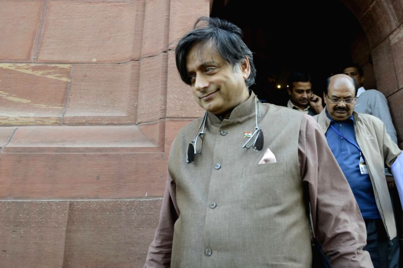 Congress MP Shashi Tharoor at the Parliament premises in New Delhi, on Dec 3, 2014. - Shashi Tharoor