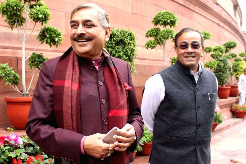 Congress MPs Pramod Tiwari and Sanjay Singh at the Parliament in New Delhi, on March 3, 2015. - Sanjay Singh