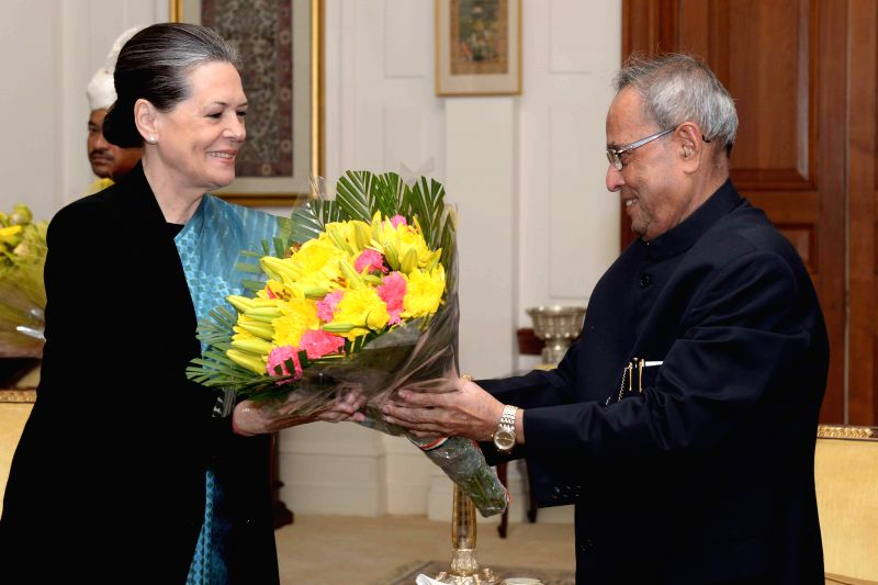 Congress president Sonia Gandhi calls on President Pranab Mukherjee to greet him on his 78th birthday at Rashtrapati Bhavan in New Delhi, on Dec 11, 2014. - Pranab Mukherjee