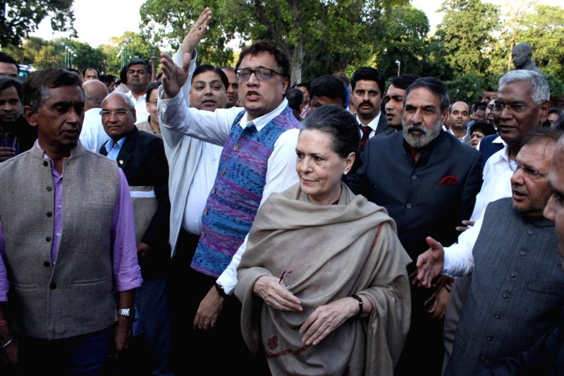 Congress president Sonia Gandhi leads a march of leaders and MPs of 10 political parties from the Parliament House to the Rashtrapati Bhawan to protest against the controversial land ... - Sonia Gandhi, Sharad Yadav and Anand Sharma