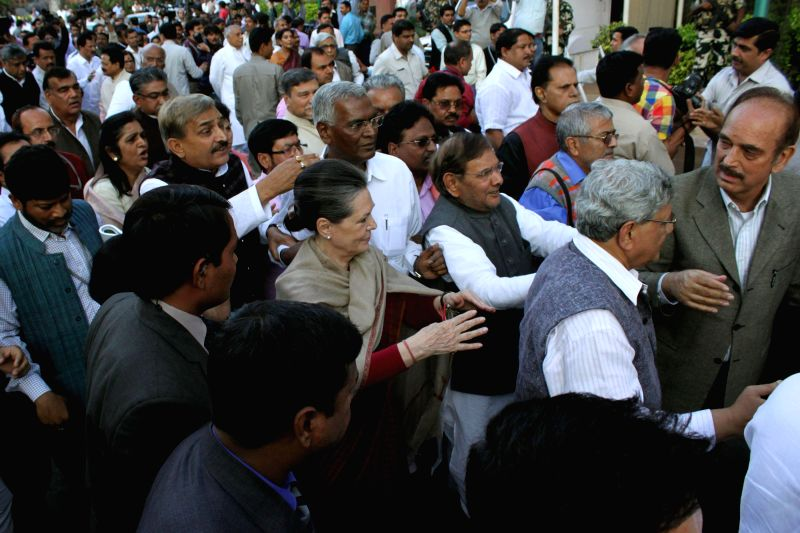 Congress president Sonia Gandhi leads a march of leaders and MPs of 10 political parties from the Parliament to the Rashtrapati Bhawan to protest against the controversial land acquisition ... - Sitaram Yechury, Sonia Gandhi and Sharad Yadav