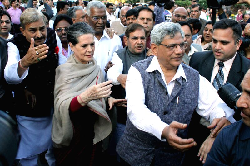 Congress president Sonia Gandhi leads a march of leaders and MPs of 10 political parties from the Parliament House to the Rashtrapati Bhawan to protest against the controversial land ... - Sitaram Yechury, Sonia Gandhi and Sharad Yadav