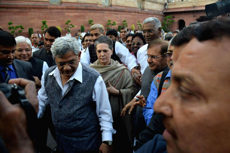 Congress president Sonia Gandhi leads a march of leaders and MPs of 10 political parties from the Parliament House to the Rashtrapati Bhawan to protest against the controversial land ... - Sitaram Yechury and Sonia Gandhi