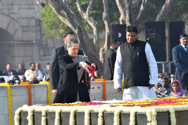 Congress president Sonia Gandhi paying homage at the samadhi of Mahatma Gandhi on the occasion of Martyr's Day, at Rajghat, in Delhi on Jan. 30, 2015. - Sonia Gandhi