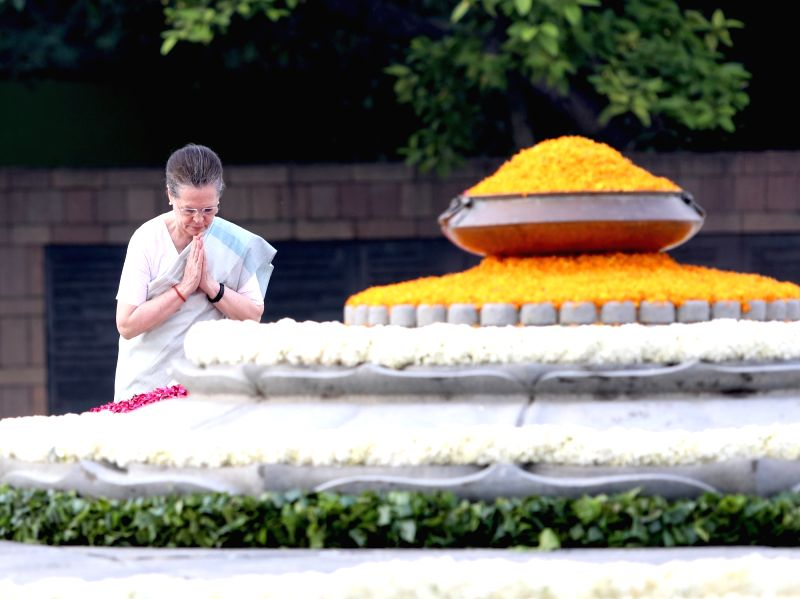 New Delhi: Congress President Sonia Gandhi pays tributes to her husband and Former Prime Minister Rajiv Gandhi on his 75th birth anniversary at Virbhoomi in New Delhi on Aug 20, 2019. (Photo: IANS)