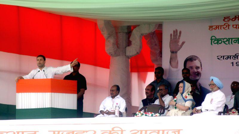 Congress vice-president Rahul Gandhi addresses during the Kisan rally at Ramlila Maidan in New Delhi, on April 19, 2015. Also seen Congress party president Sonia Gandhi, Former prime ... - Rahul Gandhi, Sonia Gandhi, Manmohan Singh and Digvijaya Singh