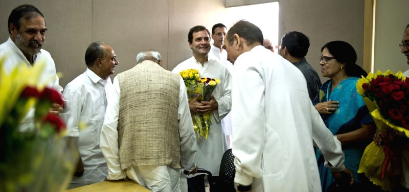 Congress vice president Rahul Gandhi interacts with senior Congress leaders on his 45th birthday celebrations at his residence in New Delhi on June 19, 2015. - Rahul Gandhi