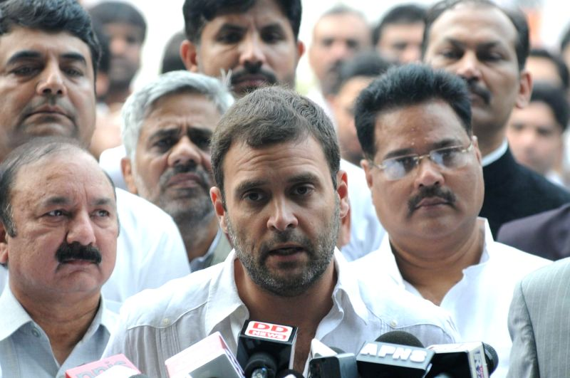 :New Delhi: Congress vice president Rahul Gandhi addresses press regarding upcoming Bihar poll results in New Delhi, on Nov 8, 2015. (Photo: IANS). - Narendra Modi and Rahul Gandhi