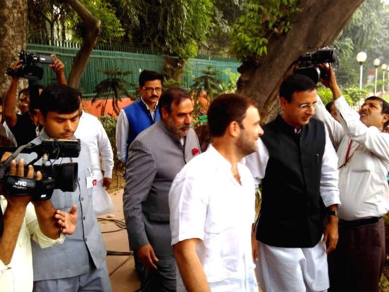 : New Delhi: Congress vice president Rahul Gandhi arrives to address press regarding upcoming Bihar poll results in New Delhi, on Nov 8, 2015. (Photo: IANS). - Narendra Modi and Rahul Gandhi
